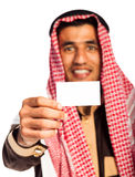 Young smiling arab showing business card in hand  on whi Royalty Free Stock Photography