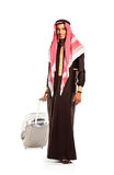 Young smiling arab with a suitcase isolated on white Royalty Free Stock Photos