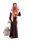 Young smiling arab with a suitcase isolated on white Stock Images