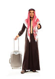 Young smiling arab with a suitcase isolated on white Royalty Free Stock Photography