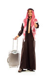 Young smiling arab with a suitcase and thumb up  on whit Stock Photography