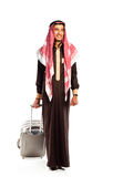 Young smiling arab with a suitcase  on white Stock Photo