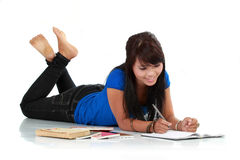 Young smiling asian woman with book Royalty Free Stock Images