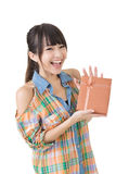 Young smiling asian woman with a gift. Stock Images