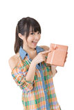 Young smiling asian woman with a gift. Royalty Free Stock Images