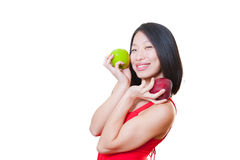 Young smiling asian woman red dress with apples on hands Royalty Free Stock Photography
