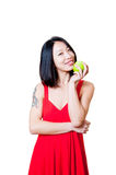 Young smiling asian woman red dress with green apple isolated Stock Image