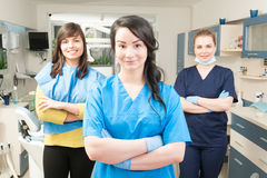 Young smiling assistant in front of her coworker and patient Royalty Free Stock Image