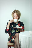 Young smiling attractive woman drinking coffee Royalty Free Stock Photo