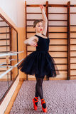 Young Smiling Ballerina Wearing black Tutu Doing exercise in training  hall Stock Images