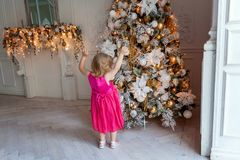 Young girl near a Christmas tree Stock Photo