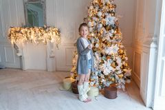Young girl with Christmas sparkler Royalty Free Stock Photos