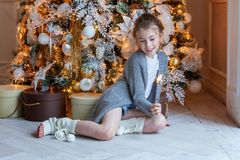 Young girl with Christmas sparkler Royalty Free Stock Photography