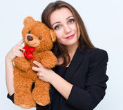 Young smiling beautiful woman holding teddy bear Royalty Free Stock Image