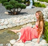 Young smiling beautiful woman with long hair outdoor portrait. Photo on nature Stock Photos