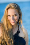 Young smiling beautiful woman with long hairs Royalty Free Stock Images