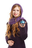 Young smiling beautiful woman in pullover and purple scarf with Royalty Free Stock Image