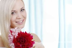 Young smiling beauty with blossom Stock Photography