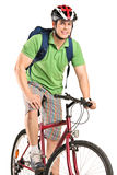 A young smiling bicyclist posing on a bicycle Stock Photos