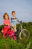 Young smiling bikers rest outdoors Royalty Free Stock Photos