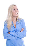 Young smiling blond and isolated business woman in blue looking Stock Photography