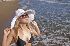 Young smiling blond woman on a beach Stock Image