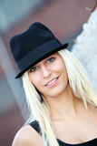 Young, smiling blond woman with a hat Royalty Free Stock Images