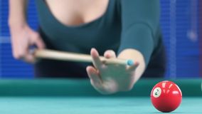 Young smiling blond woman playing billiards. Slow stock video footage