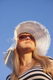 Young smiling blond woman with white hat Royalty Free Stock Photos