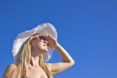 Young smiling blond woman with white hat Stock Image
