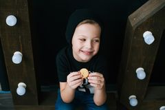 Young smiling boy eating cookie. Closeup Stock Image