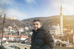 Young smiling boy in front of the prizren stone bridge Royalty Free Stock Image