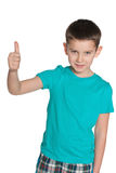 Young smiling boy holds his thumb up Royalty Free Stock Photography