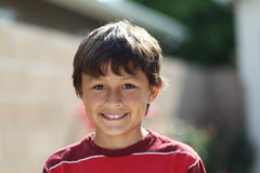 Young smiling boy outside Stock Photos