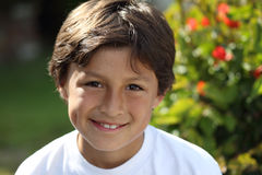 Young smiling boy in the park Stock Photography