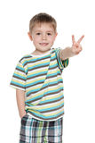 Young smiling boy shows victory sign Stock Images