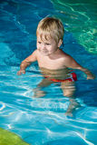 Young smiling boy in the swimming pool. Happy young smiling boy in the swimming pool Royalty Free Stock Photos