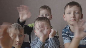 Young smiling boys waving their hands stock footage