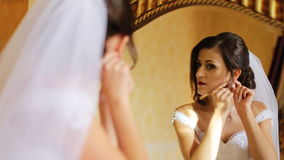 Young smiling bride preparing for the best day of her life called wedding. stock footage