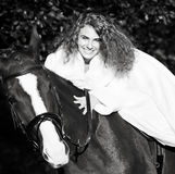 Young smiling bride riding on  horse Royalty Free Stock Image