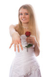 Young smiling bride with rose show ring on hand Royalty Free Stock Photography