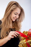 Young smiling brunette. Girl with big gift Stock Photography