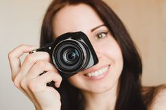 Young smiling brunette girl with camera stock images