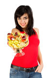 Have some Fruits. Young smiling brunette girl holding a fruit salad isolated on white Royalty Free Stock Image