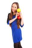 Young smiling brunette girl holding three apples Stock Photography