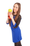 Young smiling brunette girl holding three apples Stock Photo