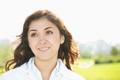 Young smiling brunette looking up Royalty Free Stock Photo