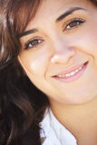 Young smiling brunette woman. Closeup photo Royalty Free Stock Photography