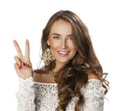 Young smiling brunette woman showing victory or peace sign Royalty Free Stock Photos