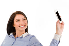 Young smiling brunette woman taking a selfie Stock Images
